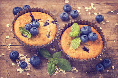 blueberries: Blueberry muffins in old metal cupcake holder