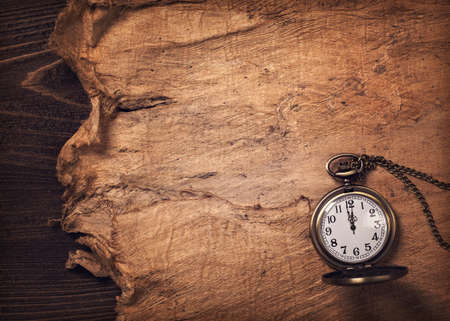 pocketwatch: Old vintage paper and a watch
