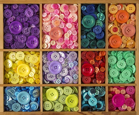 assortment: Colorful buttons in the brown wooden box