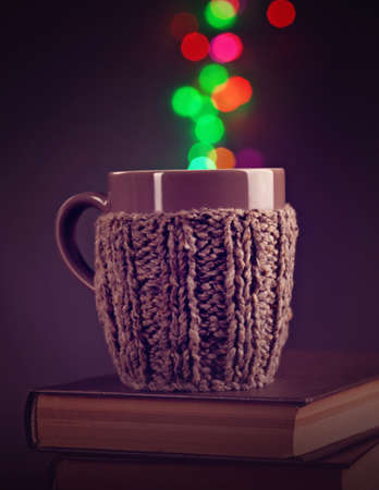 coffee mugs: Hot beverage in a brown mug and bokeh Stock Photo