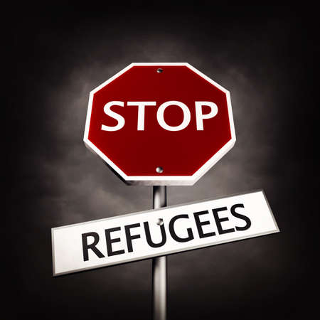 protest signs: Stop refugees as a road sign