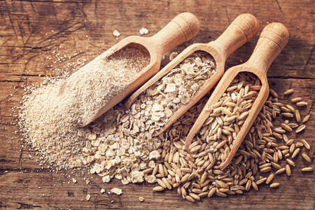 Oat flakes, seeds and bran in spoons Фото со стока - 47108913