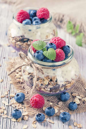 oats: Chia seeds pudding with raspberries and blueberries Stock Photo