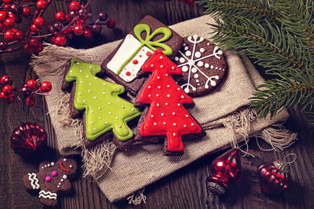 Chocolate christmas cookies on a wooden brown background
