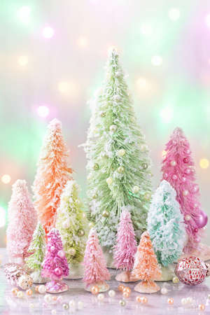 pastel: Pastel colored christmas trees and decoration Stock Photo