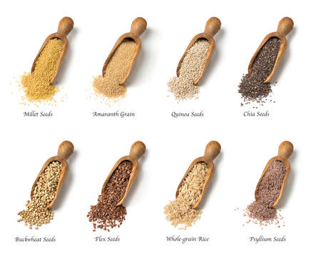 grains: Wooden spoons with gluten free seeds Stock Photo