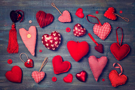 multiple objects: Red hearts on a wooden background Stock Photo