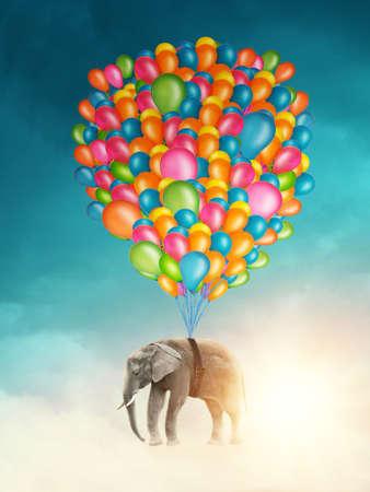 Volar elefante con globos de colores