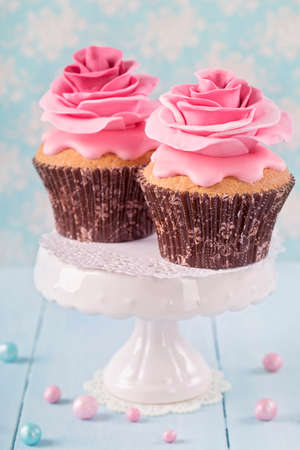 sugarpaste: Two cupcakes with rose flowers Stock Photo