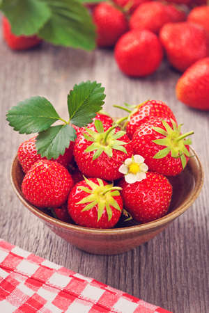 nutrition health: Red strawberries in a bowl