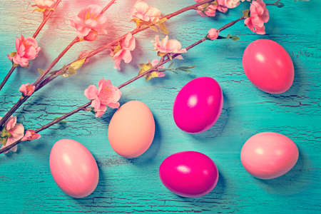 shabby: Pink easter eggs on a blue background