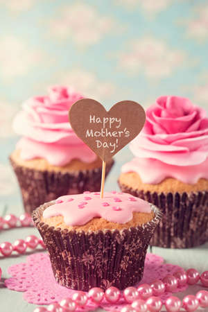 Cupcake with rose flowers for Mother's Day Stock Photo