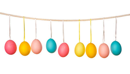 hanging: Easter eggs hanging on the clothesline isolated on white background