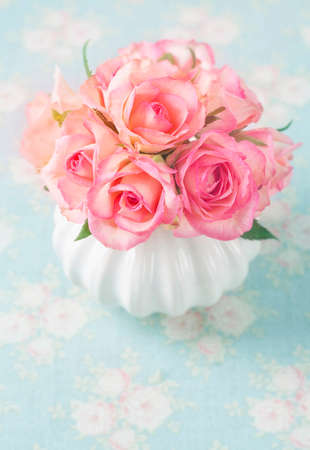 pink wedding: Pink roses in a white vase