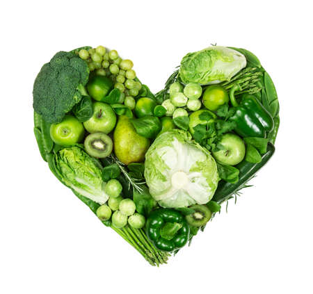 Heart of green fruits and vegetables isolated on a white background