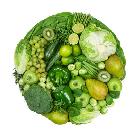 Circle of green fruits and vegetables isolated on a white background