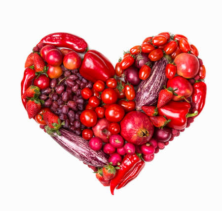 Heart of red fruits and vegetables isolated on a white background