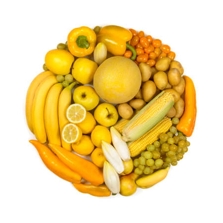 Circle of yellow fruits and vegetables isolated on a white background