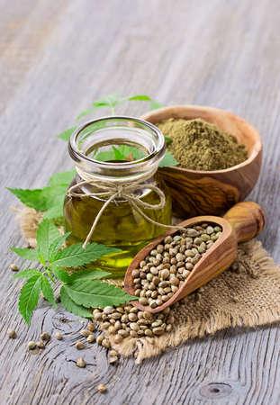 Hemp oil n a glass jar and hemp seeds