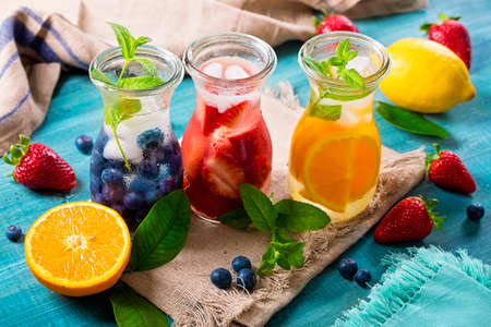 Summer fruit drinks on a wooden table