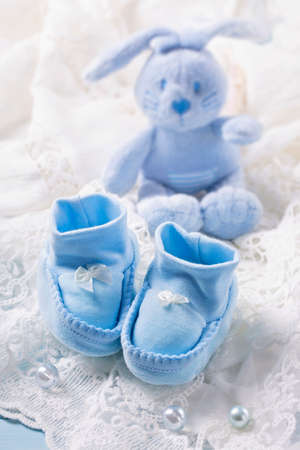 baby blue: Blue baby shoes on a white fabric