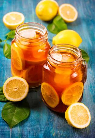 Iced tea with lemon in glass jars
