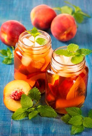 glass jars: Peach iced tea in glass jars Stock Photo