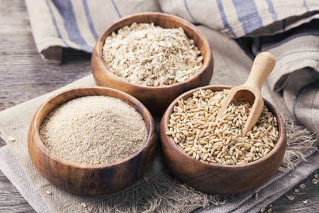 bran: Oat flakes, seeds and bran in bowls