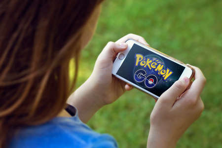 play popular: Vienna, AUSTRIA - August 1, 2016: Pokemon Go logo on the phone. Pokemon Go is a location-based augmented reality mobile game.