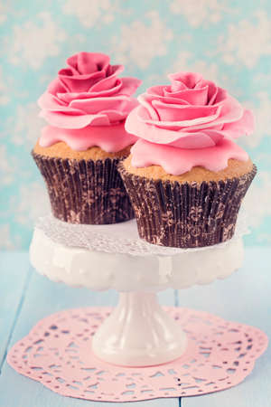 gumpaste: Two cupcakes with rose flowers Stock Photo