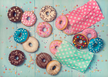 Donuts on a pastel blue wooden background Stock Photo