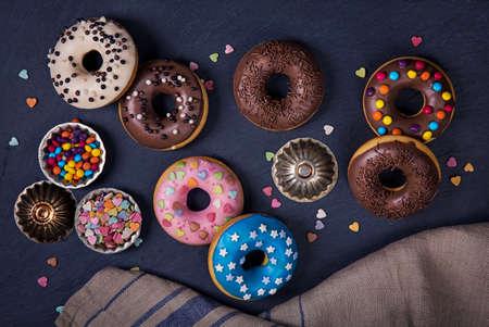 doughnut: Donuts on a black slate surface Stock Photo