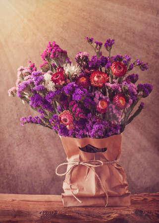 antique vase: Lilac autumn flowers in a bag