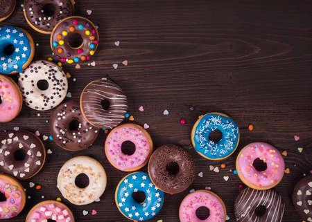 doughnut: Donuts on a dark wooden background