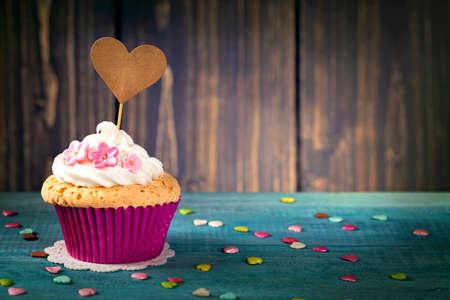 Cupcake with a heart cakepick