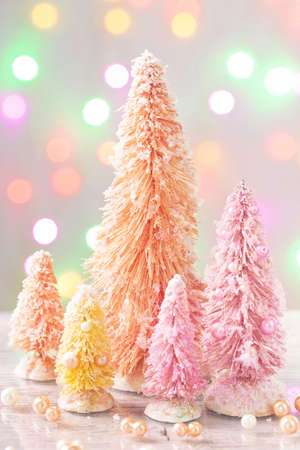Pastel colored christmas trees and decoration Stock Photo