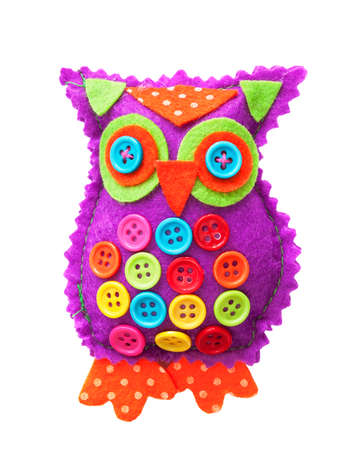 handicraft: Handmade fabric owl isolated on a white background