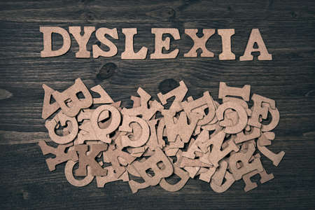 problem: Word dyslexia on a dark wooden background Stock Photo