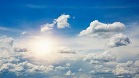 fluffy clouds: Sky with beautiful clouds and sun Stock Photo
