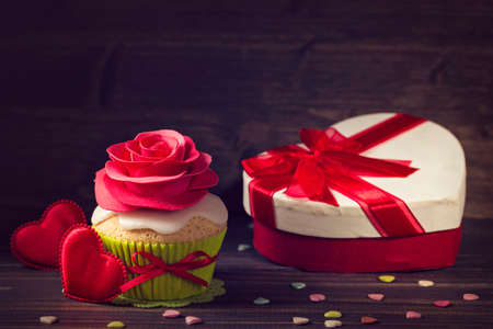 Cupcake with rose and a present for valentines day
