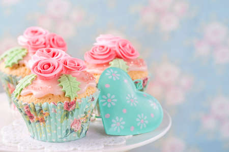 Pastel colored cupcakes with roses