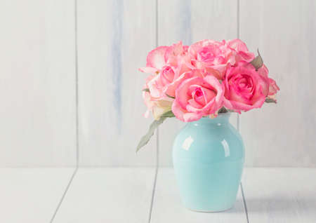 textured backgrounds: Pink roses in a white vase