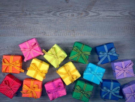 multiple: Colorful gift boxes above the wooden background