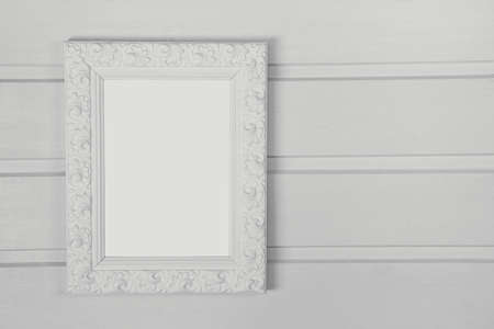 blank spaces: Vintage white wooden picture frame