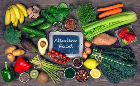 Alkaline foods above the wooden background Foto de archivo