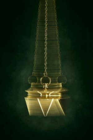 Swinging pendulum used for hypnotism or foretelling Stock Photo