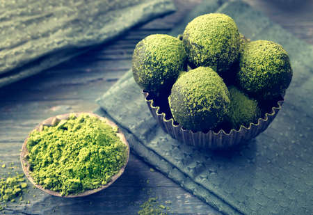 Matcha energy balls dusted with bright green matcha powder