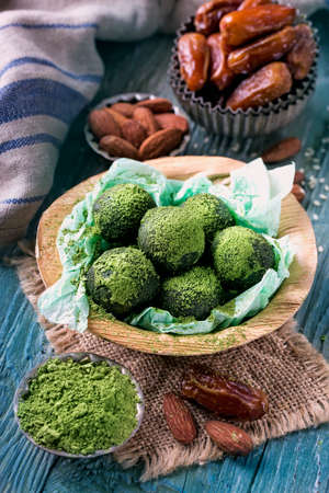 Matcha energy balls from dates and almonds Фото со стока - 80092429