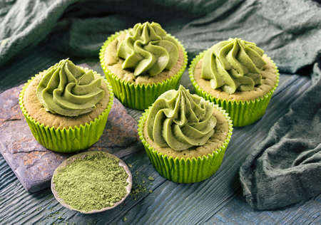 raw: Matcha cup cakes on a wooden background