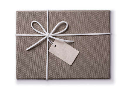 xmas background: Grey gift box with a tag isolated on a white background
